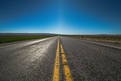 American highway horizon, lonely road and field. Royalty Free Stock Image
