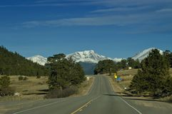 American Highway with mountain. American Highway in Colorado with snow covered mountains Royalty Free Stock Photo