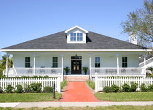 American Home. Typical American style home with white picket fence, large porch and swing stock photos