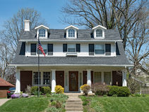 American Home with Dormers & Open Porch Royalty Free Stock Photo
