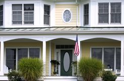 American home. front detail. Front door of the american house with flag royalty free stock photography