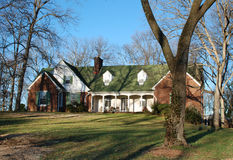 American Home on Wooded Lot 51. Modest one and a half story home on a partially wooded lot Royalty Free Stock Photo