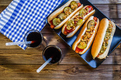 American hot dog with pickles,onions, ketchup, mustard and two soda Royalty Free Stock Photography