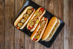 American hot dog with pickles,onions, ketchup and mustard Stock Photo