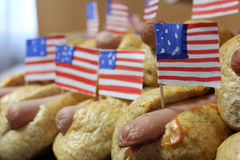 American hot dogs with small American flags close plan, bun and sausage. American hot dogs with small American flags close plan Royalty Free Stock Image