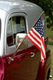 American Hot Rod. A closeup of the side of a customised car, with an American flag hanging from a flagpole attached to the door Stock Photos