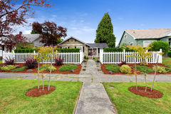 American house exterior with beautiful front yard landscape desi Royalty Free Stock Image