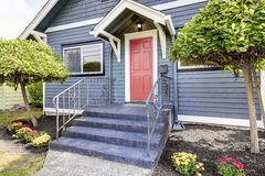 American house exterior in blue color with red front door Stock Images