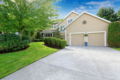 American house exterior and curb appeal. Big american house with garage and driveway view Royalty Free Stock Image