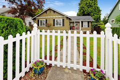 American house exterior with white closed wooden gate Royalty Free Stock Photos