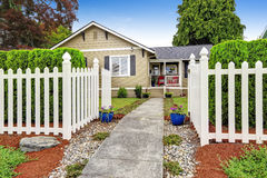 American house exterior with white wooden fence Royalty Free Stock Photography