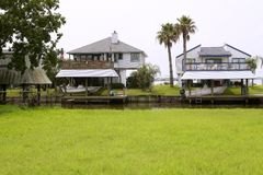 American houses in south Texas river boats Royalty Free Stock Image