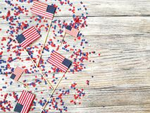 American independence Day, celebration, patriotism and holidays concept - flags and stars on the 4th of July party on top on woode. American independence Day Royalty Free Stock Image