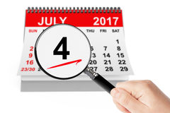 American Independence Day Concept. 4 July 2017 calendar with mag. Nifier on a white background Royalty Free Stock Photo