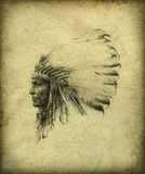 American Indian Chief. Profile portrait of an American Indian with the traditional feather headdress. Pencil on paper, slightly processed Royalty Free Stock Photography