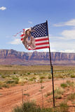 American Indian Flag Travel. An American flag with a native American Indian that is falling apart after flying for so long Royalty Free Stock Photos