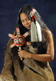 American Indian Girl. Indian Lady With Black Hair, Feathers and Rattle Royalty Free Stock Image