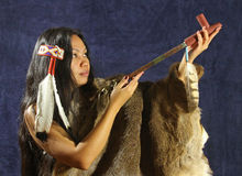 American Indian Girl. Indian Lady With Black Hair, Feathers and Peace Pipe royalty free stock photo