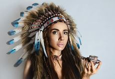 American Indian girl smoking a pipe Royalty Free Stock Image
