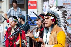 American Indians in Istanbul. Unidentified Amerindians perform in traditional costumes during street show at Istiklal Street on July 06, 2010 in Istanbul Royalty Free Stock Images