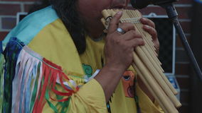 American Indians playing wooden flute close up shot no had stock footage