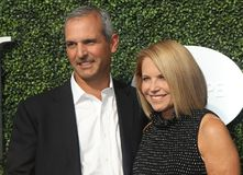 American journalist and author Katie Couric and John Molner on the blue carpet before US Open 2017 opening night ceremony Royalty Free Stock Images