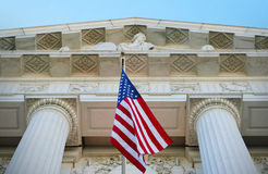 American Justice. American flag by a justice building with columns Royalty Free Stock Images