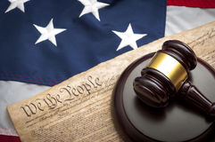 American justice system, the judicial. American flag, US constitution and a judge's gavel symbolizing the American justice system or the Judicial Branch of stock photography