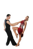 American latin dance. The young man and the girl dancing the Latin American dance Stock Photo