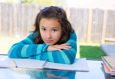 American latin teen girl doing homework on backyard Royalty Free Stock Image