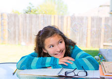 American latin teen girl doing homework on backyard Royalty Free Stock Photos