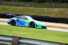 American Le Mans Series Road America. Elkhart Lake, Wisconsin, USA - August 11, 2013: The #17  Porsche 911 GT3 of Team Falken Tire during the American Le Mans Royalty Free Stock Photo