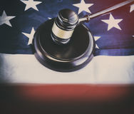 American legal law concept image. Gavel on American flag Stock Photo