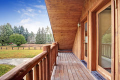 American log cabin house exterior. Landscape view from the balcony. Royalty Free Stock Images