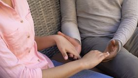 American loving couple holding hands sitting on bench, trusting relationships. Stock footage stock video