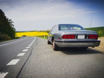 American vintage car by the road Royalty Free Stock Photo