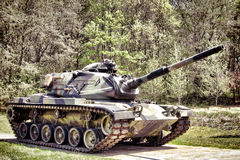American M60 Patton Combat Army Main Battle Tank. American M60 Patton full tracked combat US army main battle tank with 105 cannon gun and camouflage paint on a Stock Photos