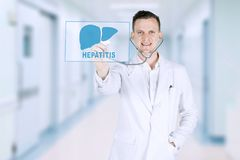 American doctor using a stethoscope on studio. American male doctor touching virtual screen with a liver or heart symbol and Hepatitis text with a stethoscope Stock Photography