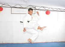 American man in karate suit, suspended in mid air Stock Photos