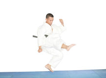 American man in karate suit, suspended in mid air Stock Photo