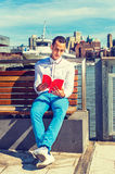 American Man Reading Book Outside in New York Royalty Free Stock Photography