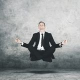American manager levitating during doing meditation royalty free stock photography
