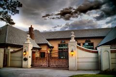 American Mansion Home and Gate in HDR royalty free stock photo