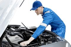 American mechanic with broken car and laptop Stock Photos