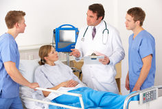 American medical team by patient's bed Stock Image