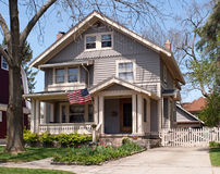 American Midwest House. All-American Midwest house with flag & picket fence Royalty Free Stock Image