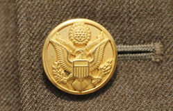 American military button. Old American military button with Latin inscriptions E pluribus unum stock photography