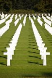 Military Cemetery Crosses In Line. The American military cemetery Henri-Chapelle near Aubel in Belgium with white crosses in rows Royalty Free Stock Image