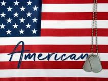 American military dog tags on flag stock photos