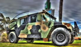 American military Humvee. Military Humvee vehicle painted in camouflage colours on display at car show in Australia . The Humvee is actually a High mobility royalty free stock photography